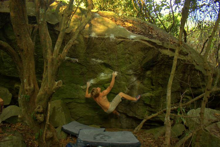 """Marijus Šmigelskis on the first ascent of """"Death Professor"""" 7C at Umgeni Valley, near Durban, South Africa."""