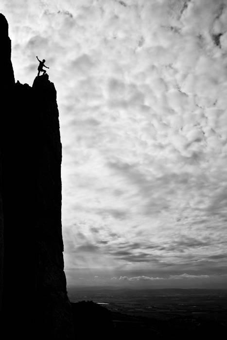 """Peter Maul on top of """"Arete Est de L'Aigilluette Lagarde"""", 6a, Dentelles de Montmirial, France."""