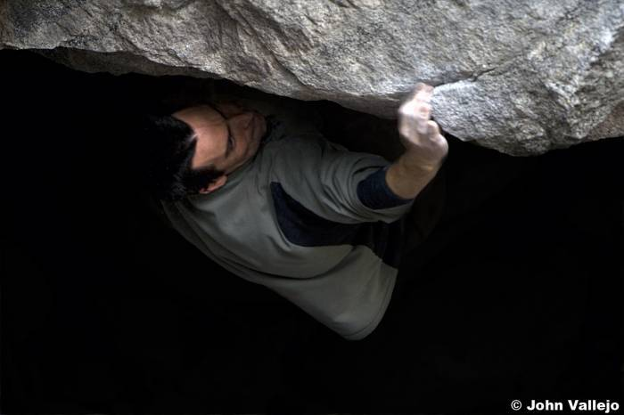 Paul Barraza coming out of the darkness on Narcissus (v11) Yosemite, USA.