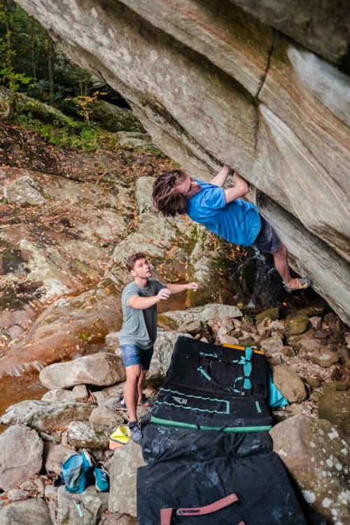 Crux move coming out of undercling.